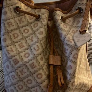 Dooney and Bourke draw string barrel style bag.